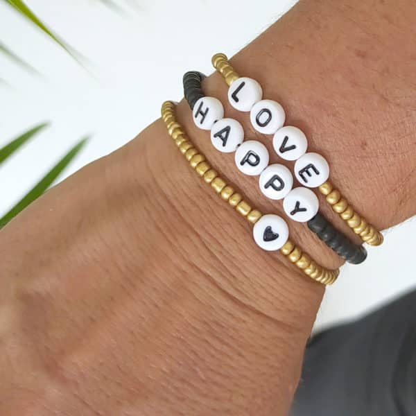 Bracelet perles lettres HAPPY noir